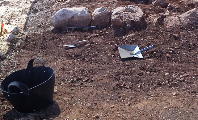an-archaeological-dig-with-some-tools-of-the-trade