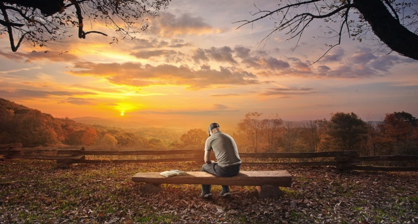 Praying on bench