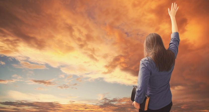 Woman praises during sunset_Bible