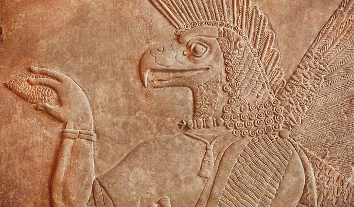 Ancient relief of an Assyrian mythological genie